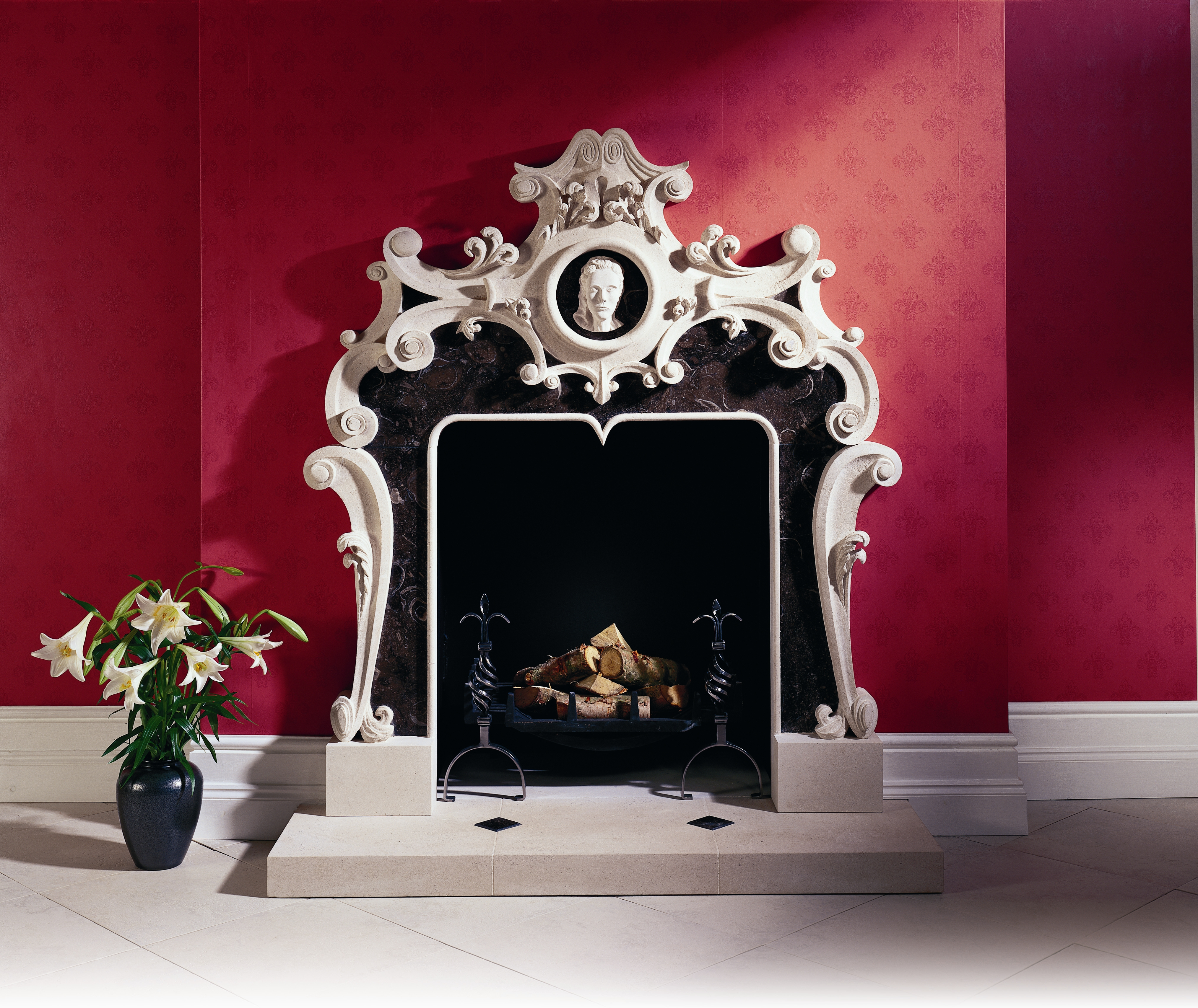 21. Portland Basebed with contrasting black fossilised limestone detail, carved in the Rococo style – Mayfair