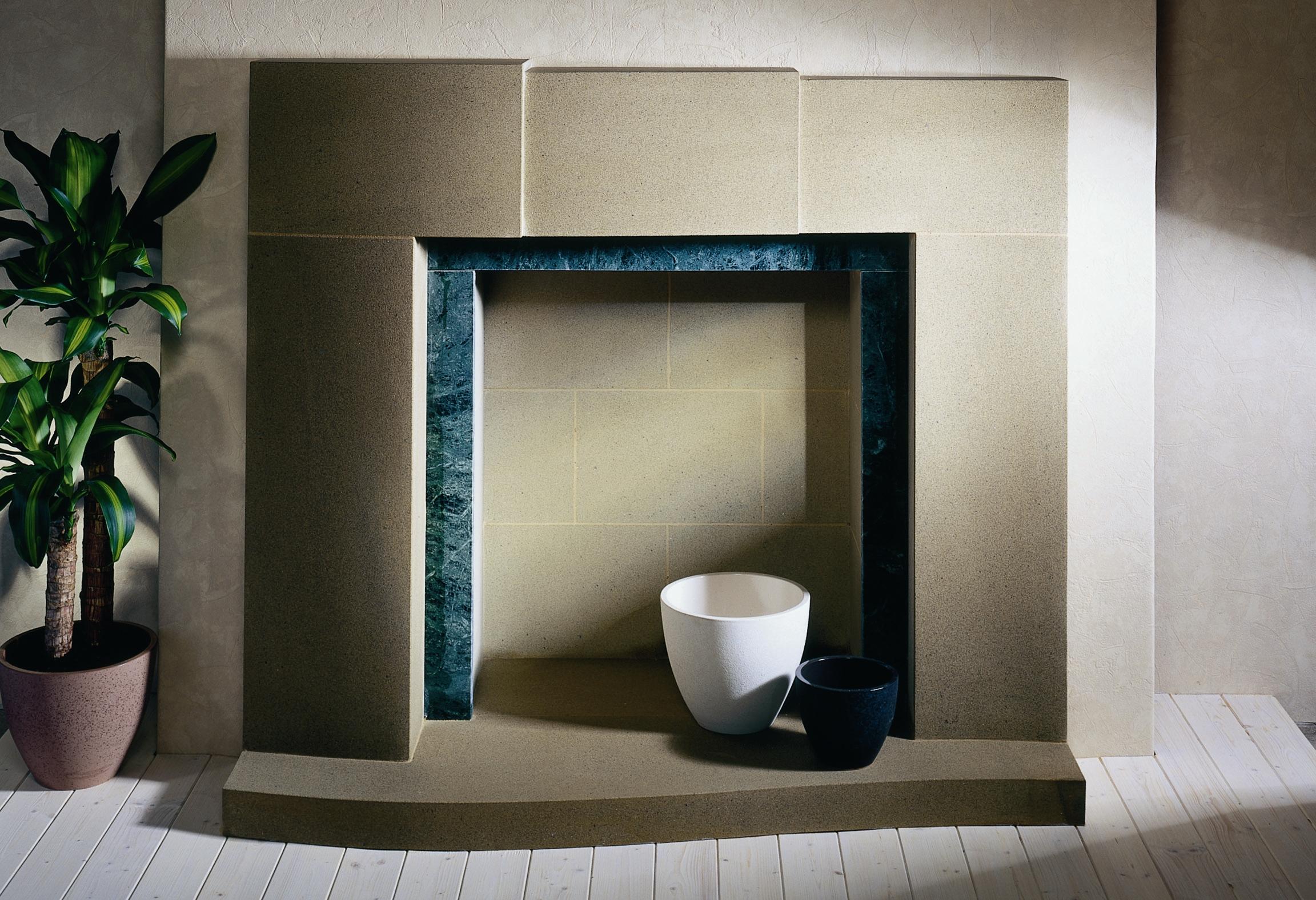 4. Derbyshire stone asymmetric fireplace with green Italian slate slips – Harrogate