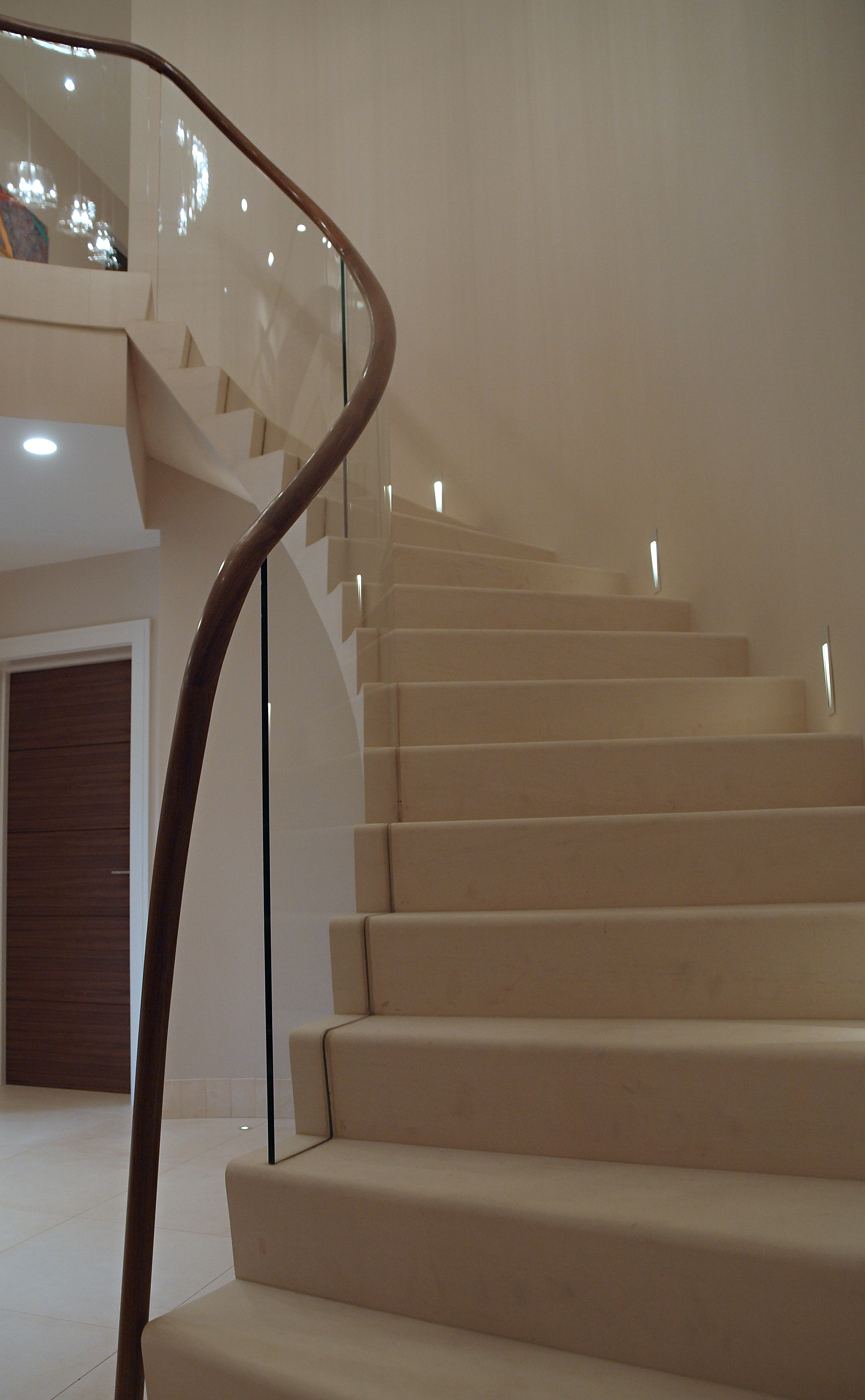 13. Cantilever Malone stone staircase with glass balustrade set into slotted tread – Hertfordshire