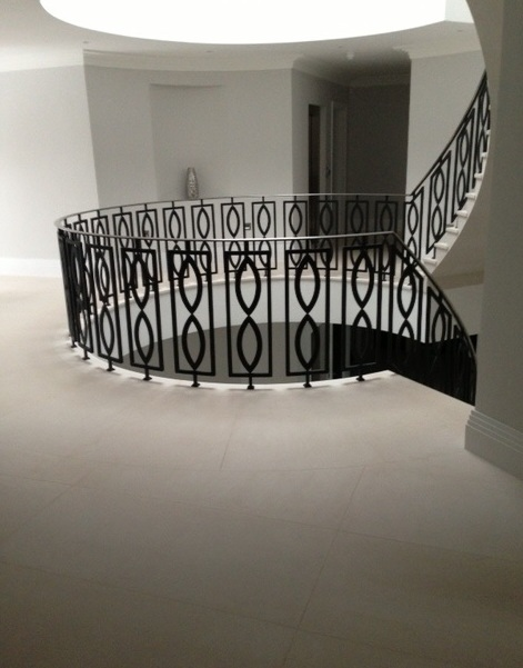17. Two-storey Moleanos stone staircase with contemporary balustrade – Hertfordshire