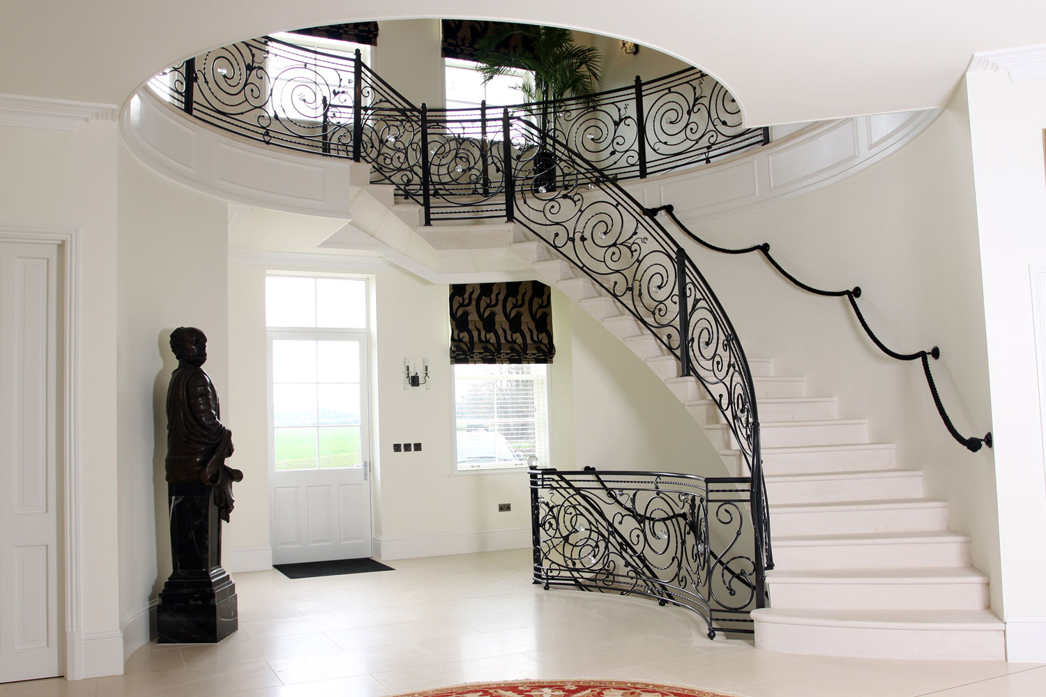 3. Moleanos stone cantilever staircase with solid stone in-flight landing – West Sussex