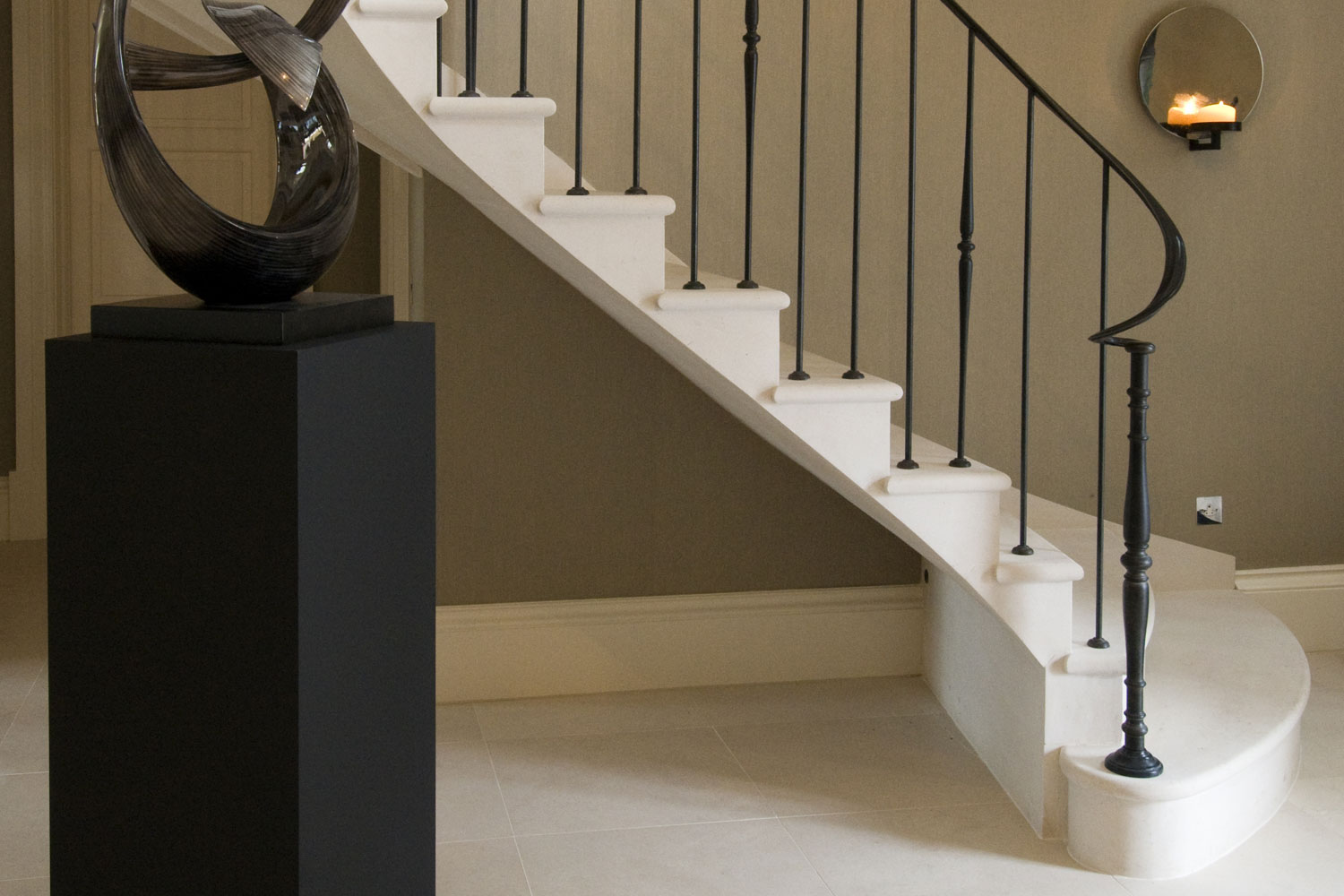 8. Helical Moleanos stone staircase with large shaped bottom tread – Surrey