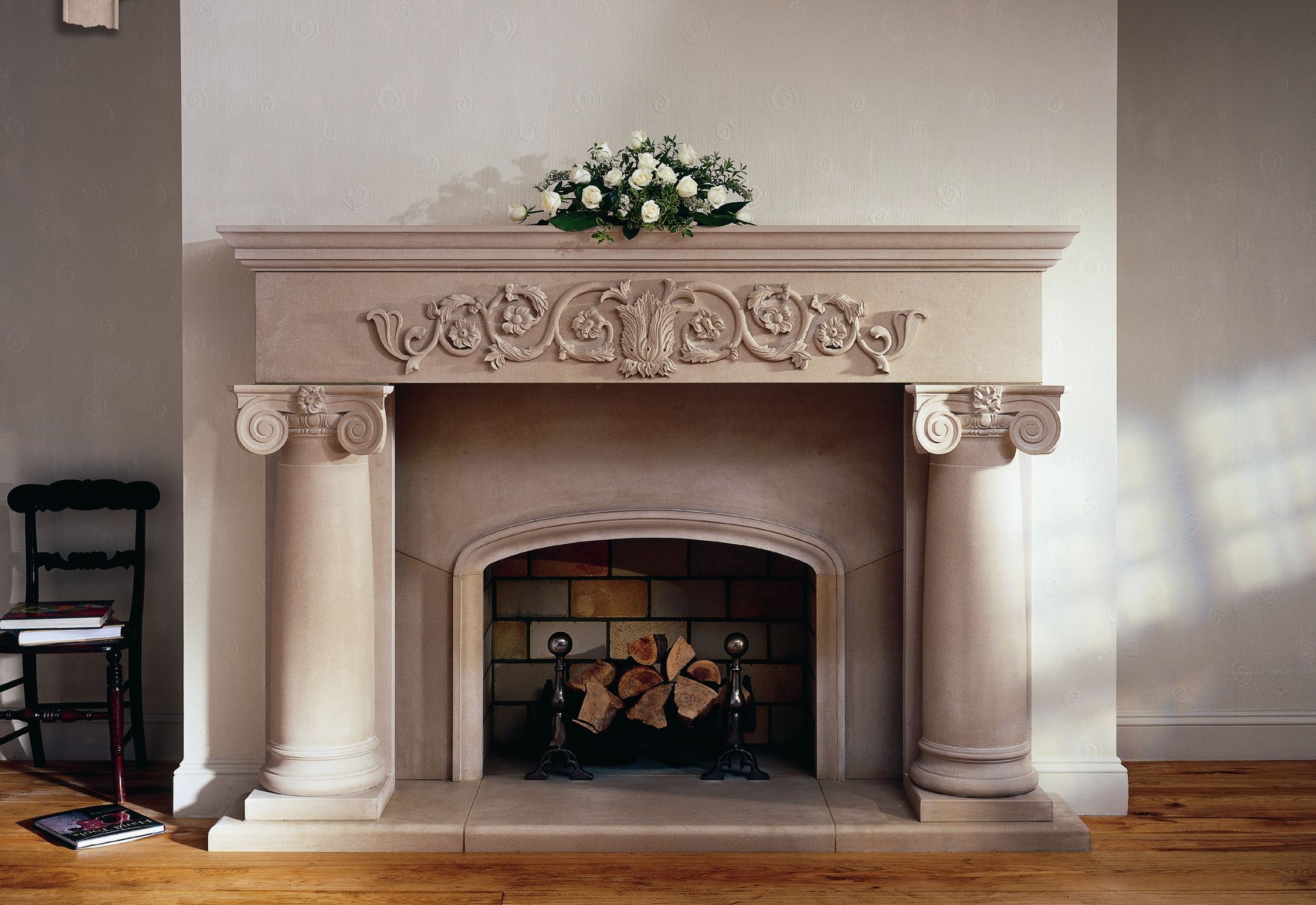 13. Classical Portland Basebed stone fireplace with heavily carved lintol and ionic columns and capitols – Staffordshire