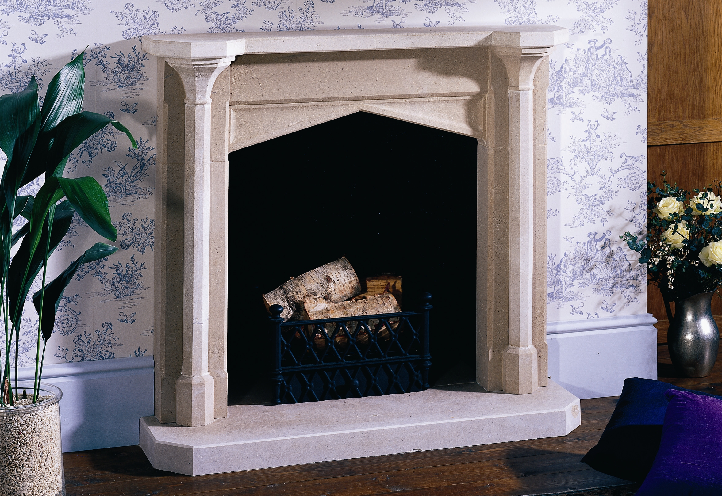 8. Simple Gothic Portland stone fireplace with black rendered chamber – Warwickshire