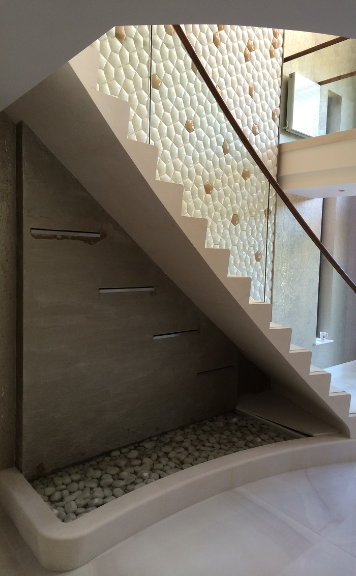 60. Moleanos staircase with glass balustrade, walnut handrail and water feature – Preston