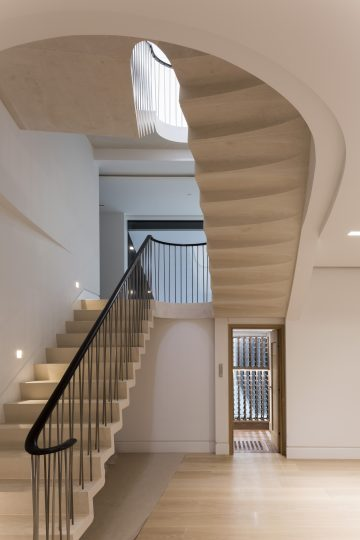 73. Moleanos Cantilever staircase with a bespoke shaped soffit